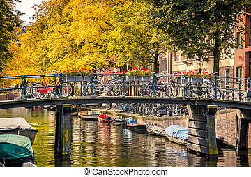 Canal in Amsterdam - Bridge over canal in Amsterdam