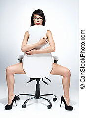 beautiful naked dark-haired woman sitting on white chair....