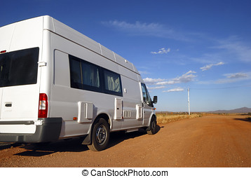Camper on its way in the desert of Australia