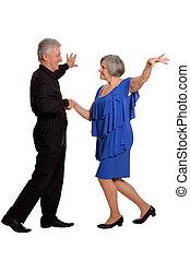 old couple dancing - Amusing old couple dancing on a white...