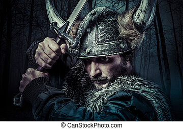 Viking warrior, male dressed in Barbarian style with sword,...