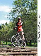 The bicyclist in old park - The city teenager has a rest,...