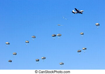 paratroopers - Military planes drop paratroopers