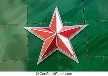 russian red star on green metallic background