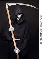 Grim reaper - Grim reaper. Studio portrait on black...
