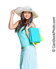 young sun-tanned woman dressed in a turquoise shirt and a...