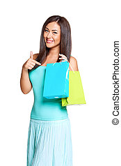 young sun-tanned woman dressed in a turquoise shirt hold...