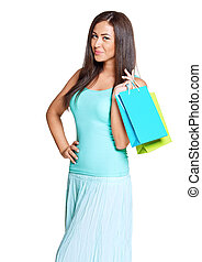 young sun-tanned woman dressed in a turquoise shirt holding...