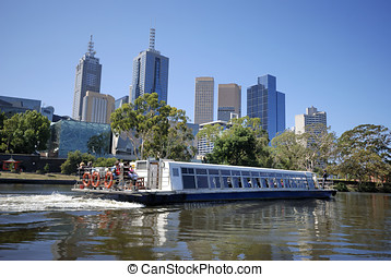Melbourne - Skyline of Melbourne with tourist boat on the...