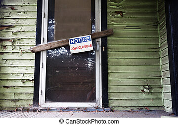 Foreclosed home - Old house with Foreclosure sign on the...