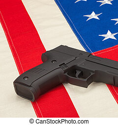 Studio shot of handgun over USA flag - 1 to 1 ratio
