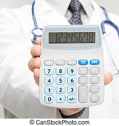 Medical doctor holding in his hand calculator - 1 to 1 ratio