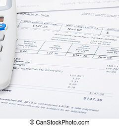 Utility bill papers with calculator - 1 to 1 ratio