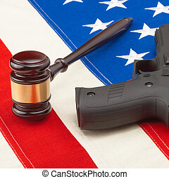 Judge gavel and gun over big US flag - 1 to 1 ratio