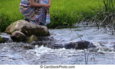 woman paper boat river - smiling blonde woman squat on stone...