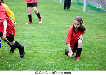 girl playing football - Young girl playing soccer