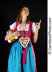 Woman in dirndl pointing at something