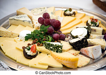 cheese platter - Cheese platter with bunch of grapes