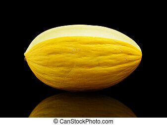 Whole yellow Canary melon isolated black in studio - Studio...