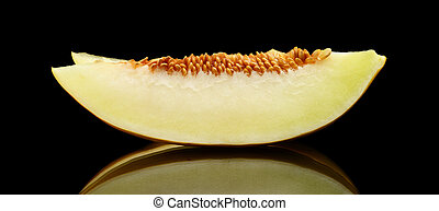 Studio shot slice Canary melon isolated black - Studio shot...