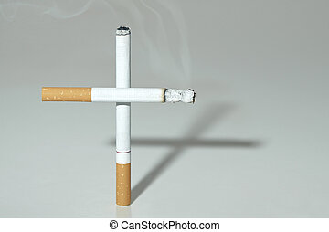 Smoking kills - Two cigarettes standing as a cross