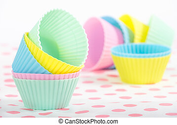 Cupcake baking cups in pastel colors Shallow depth of field...