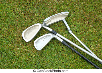 golf clubs - Three golf clubs