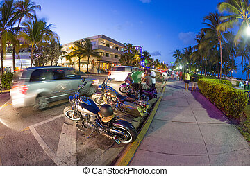 Palm trees and art deco hotels at Ocean Drive - MIAMI, USA -...