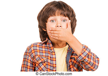 Oops Frustrated little boy covering mouth with hand and...