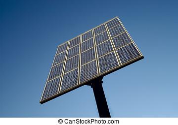 Solar panel against clear blue sky