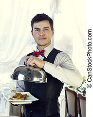 waiter with a tray of food in the restaurant hall