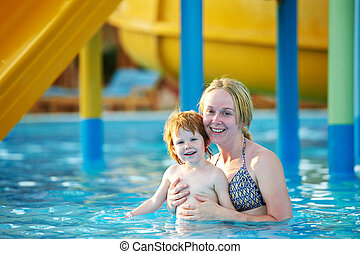 Woman and child in aquapark
