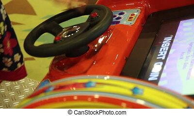 Girl turns steering wheel - Girl turns the steering wheel in...