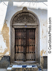 Hand crafted wooden door at Zanzibar - Hand crafted wooden...