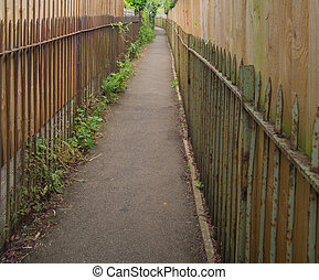 Narrow Path Between Fences - A narrow path follows between...