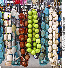 Necklaces at a market - Several beaded necklaces at an...
