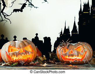 Halloween pumpkins on wood with dark background - Concept of...