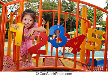 children on a playground - Cute little girl having fun