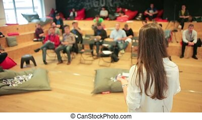 Business conference - Caucasian woman speaker teaching at...