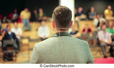 Business conference - Caucasian speaker teaching at...