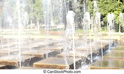 Decorative close-up of an elegant fountain. Modern fountain in a park.