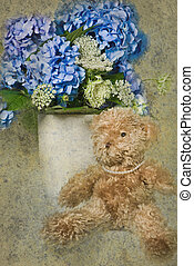Fuzzy Wuzzy - Teddy bear with hydrangea bouquet.
