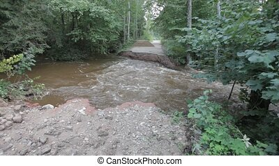 River flood broken road after heavy - TUJA, LATVIA - August...