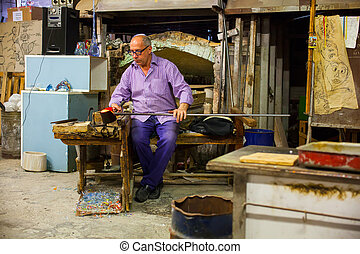 Worker of Murano furnace - MURANO, ITALY - APRIL, 26: Worker...