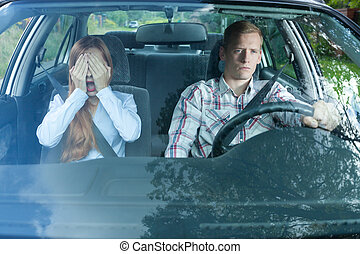 Scared woman in a car with her man
