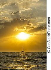 fishing boat goes sailing at sunset