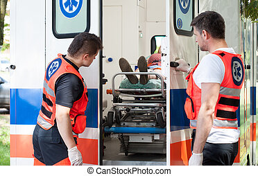Woman lying on stretcher in ambulance - Image of woman lying...