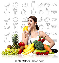 Fit smiling woman enjoying banana - Young woman eating...