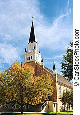 Church and Spire - Small town church on colorful fall day An...