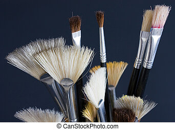 Brushes - Assorted artists paintbrushes on black background